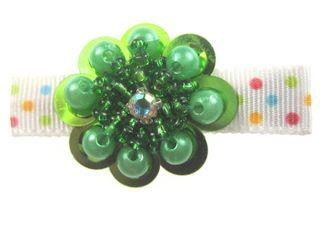 green_peral_medallion_on_polka_dot